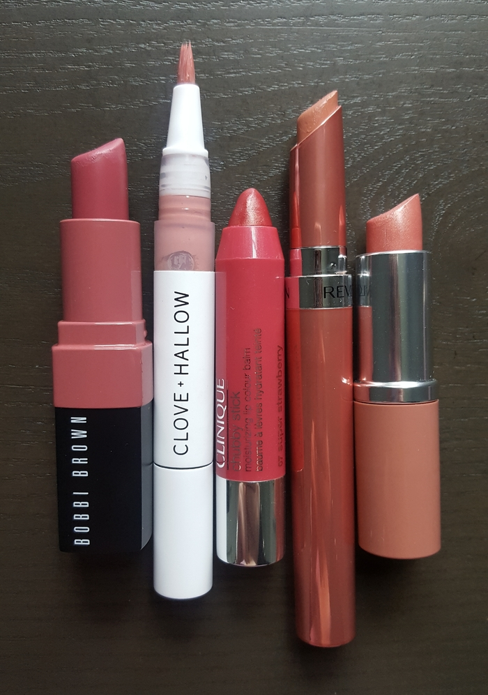 Overlay of hydrating lip products featuring Bobbi Brown, Clove + Hallow, Clinique, & Revlon