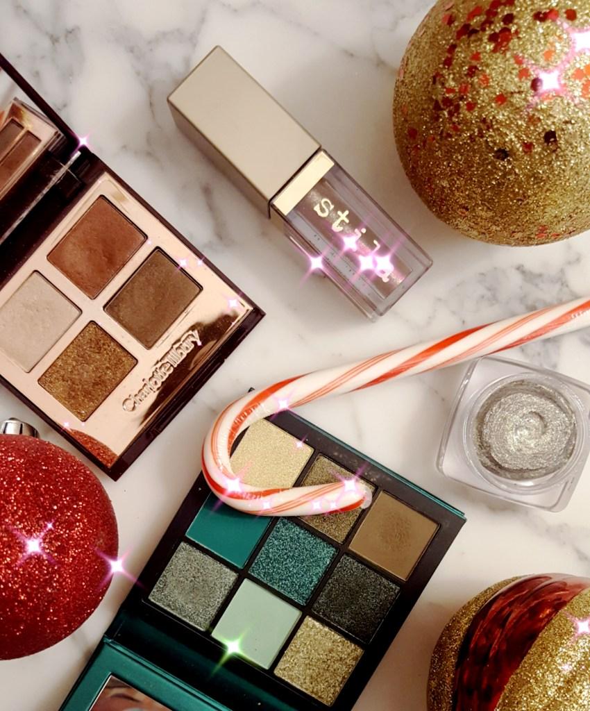 Flatlay with glitters from Stila, Charlotte Tilbury, Butter London, & Huda Beauty