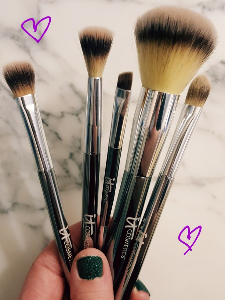 IT Cosmetics Heavenly Luxe 6-Piece Travel Brush Set. Pictured from L to R: eyeshadow brush, crease brush, eyeliner & brow brush, powder brush & concealer brush. Foundation brush not pictured.