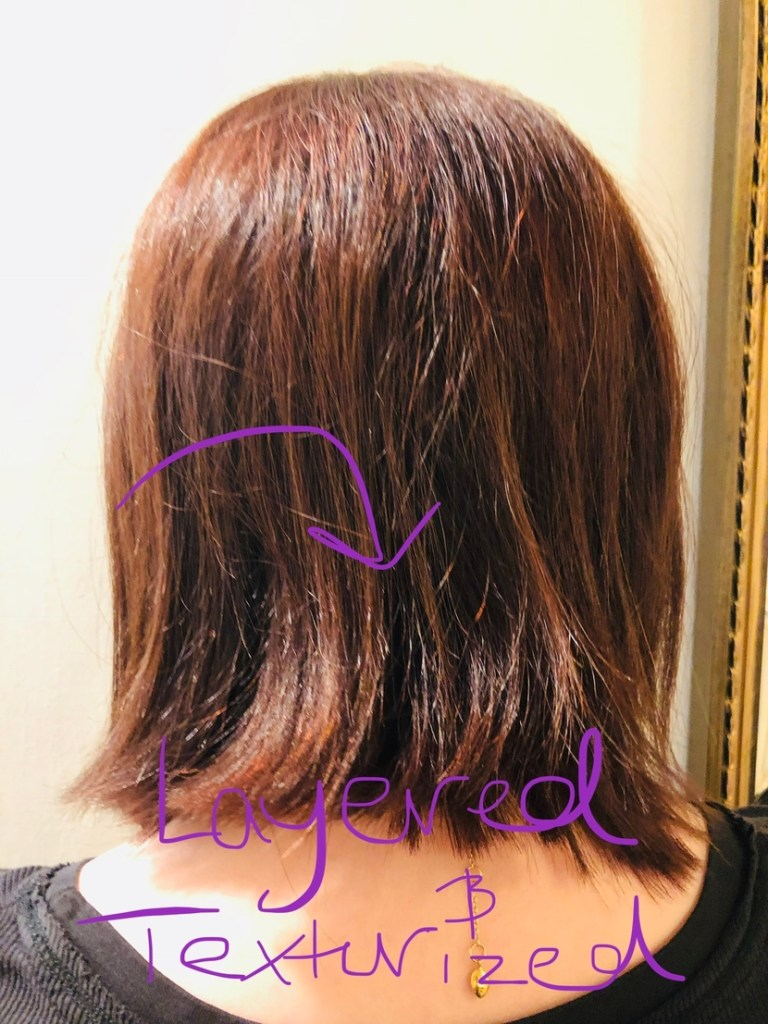 Back view of my angled lob cut