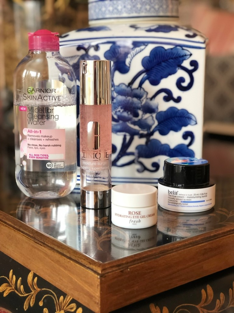 Skincare routine featuring Garnier Micellar Water, Clinique Moisture Surge Supercharged Concentrate, Fresh Beauty Rose Hydrating Gel Eye Cream, & Belif True Cream Moisturizing Bomb