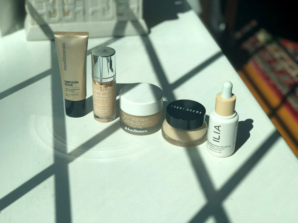 My current foundation collection including Bare Minerals, Neutrogena, Iris & Romeo, Bobbi Brown, and Ilia Beauty