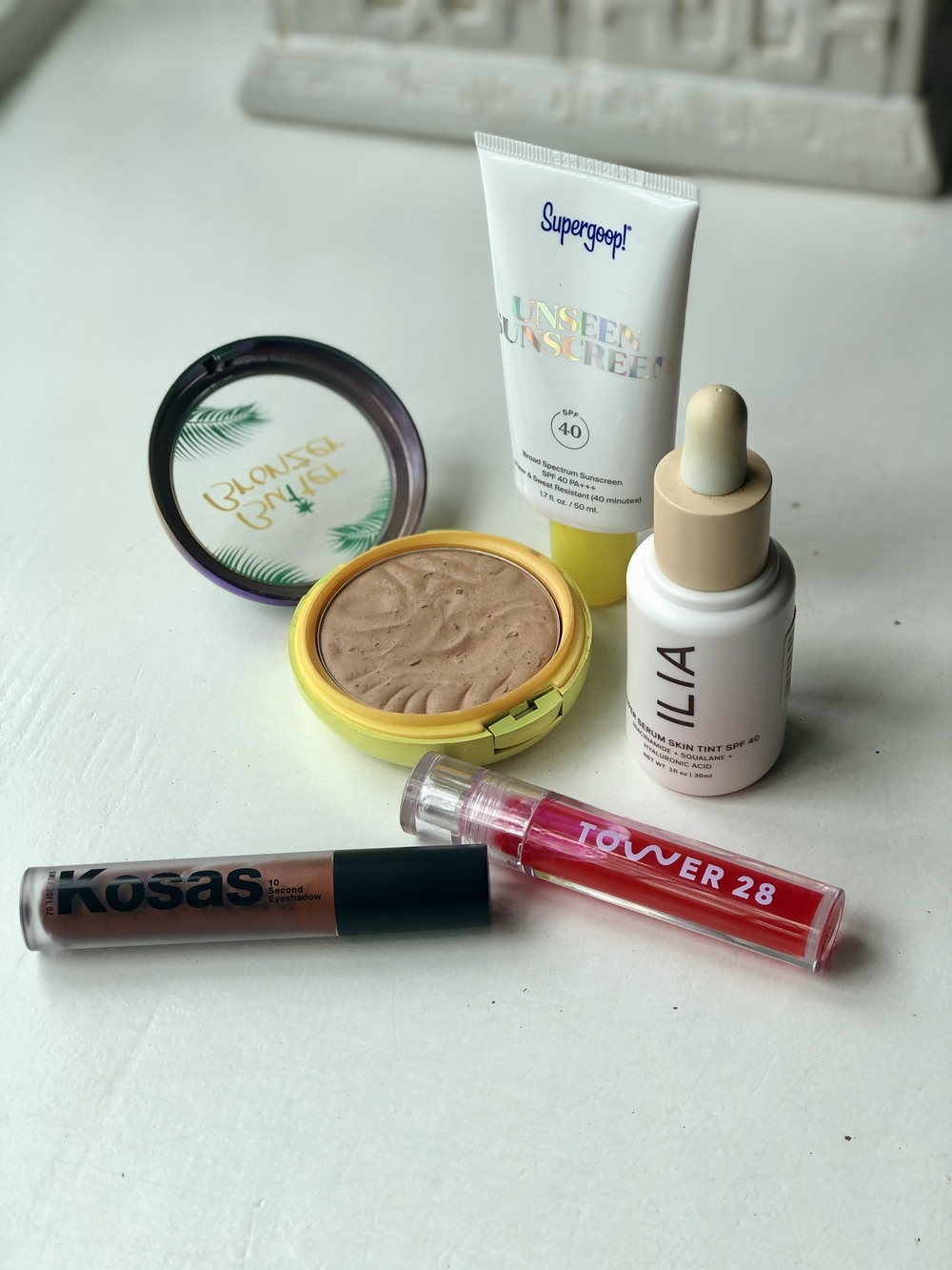 get your stash summer-ready with a good sunscreen, bronzer, tinted moisturizer, long-wear eyeshadow & lip gloss