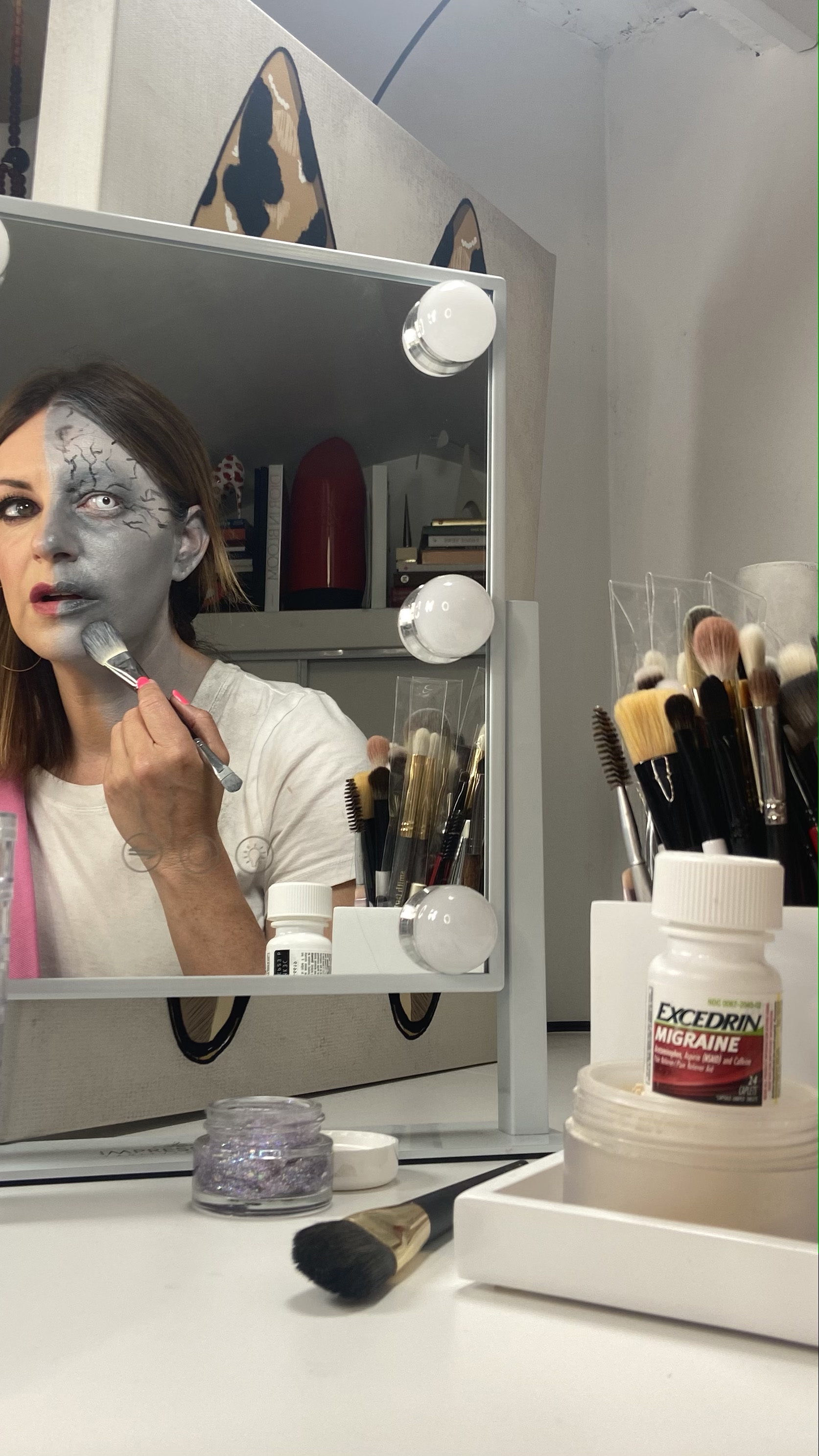 MUA Jamie Greenberg creating her first migraine-inspired look in partnership with Excedrin