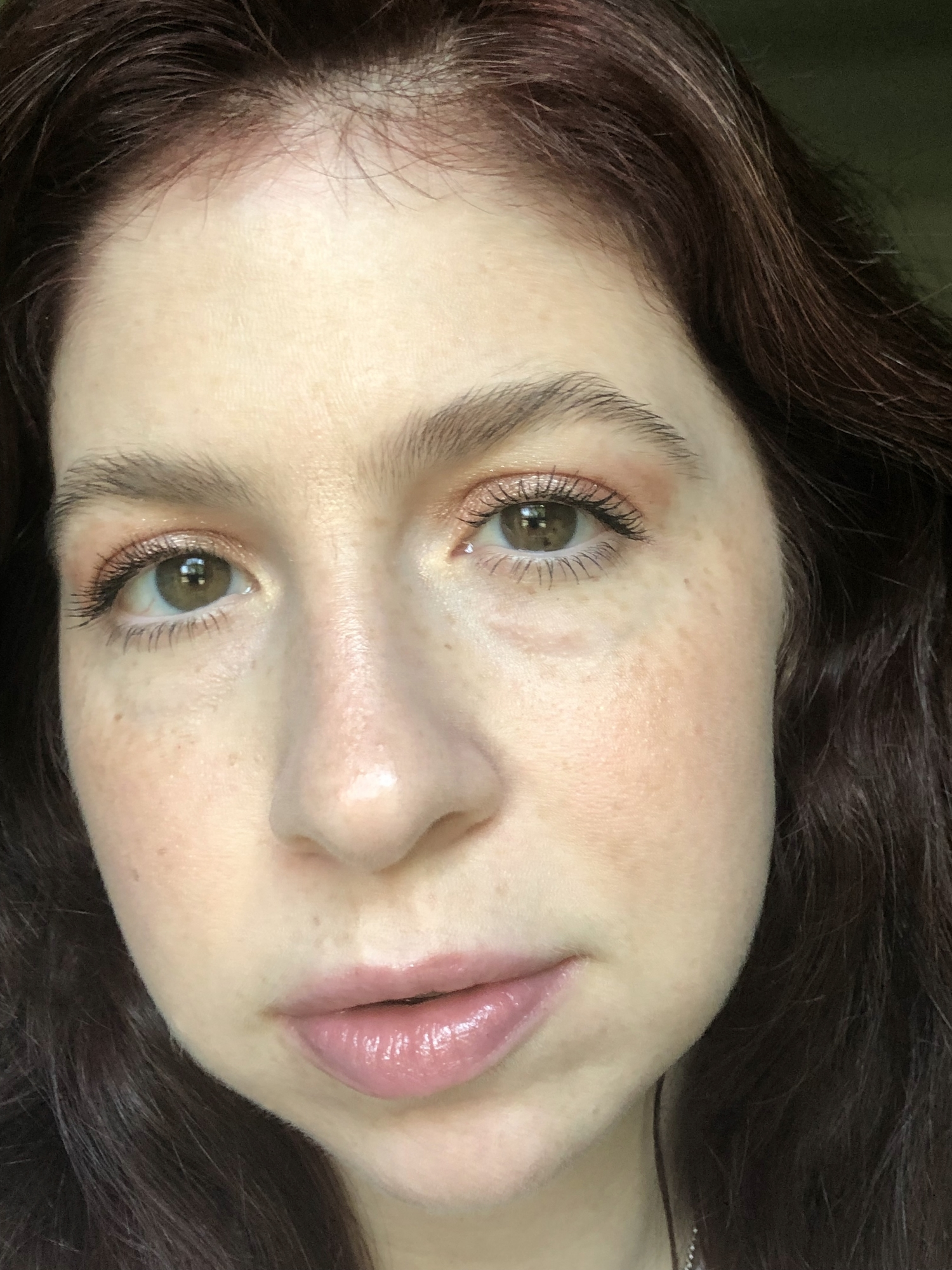 Rosy makeup look wearing products from an indie, female-owned brand