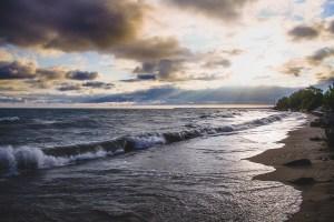 Sandy beach with waves.