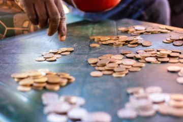 Coins are counted by members of the Community Savings Group
