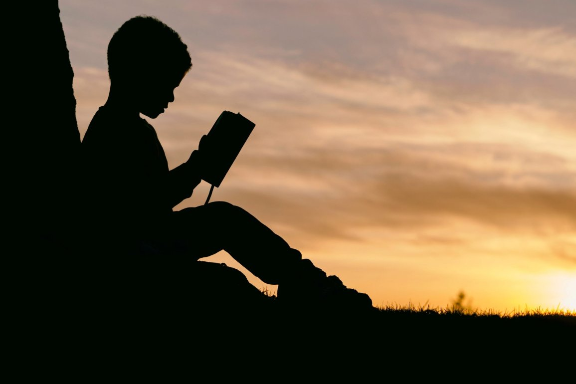 Silhouette of a young person studying
