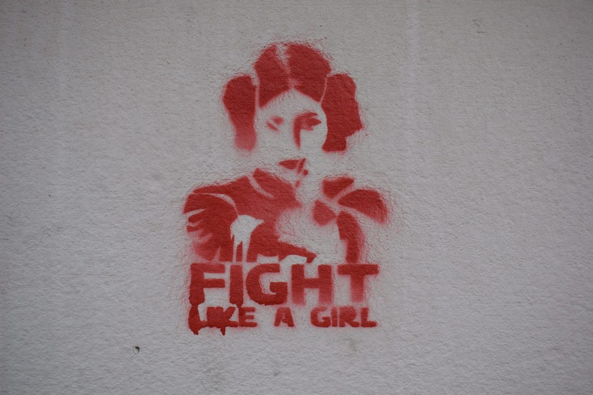"An illustration of a girl with ""Fight like a girl"" written under"