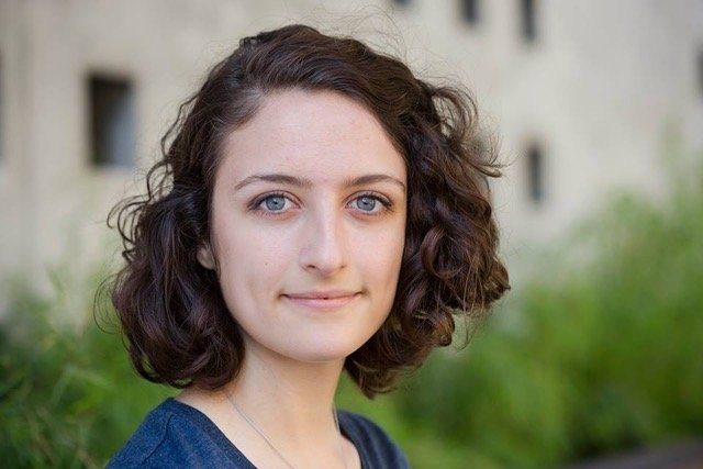 A photograph of Sadie deCoste, a young climate change leader
