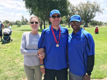 South Bay golf coach Kaion Smith and athlete Raymond Gelsing