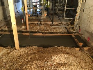Concrete footer for the new interior wall.