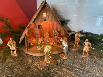 This is our family creche, purchased while we lived in Spain back in early 1960's (where I was born). It was always my favorite Christmas decoration to put up at my Mom's (Nancy Gamber's) house. When she came to live with us 7 years ago, I continued to enjoy setting it up. It's a gorgeous hand carved wood set. It is definitely a cherished family heirloom that I'm sure my boys will fight over one day. :) Ann G.