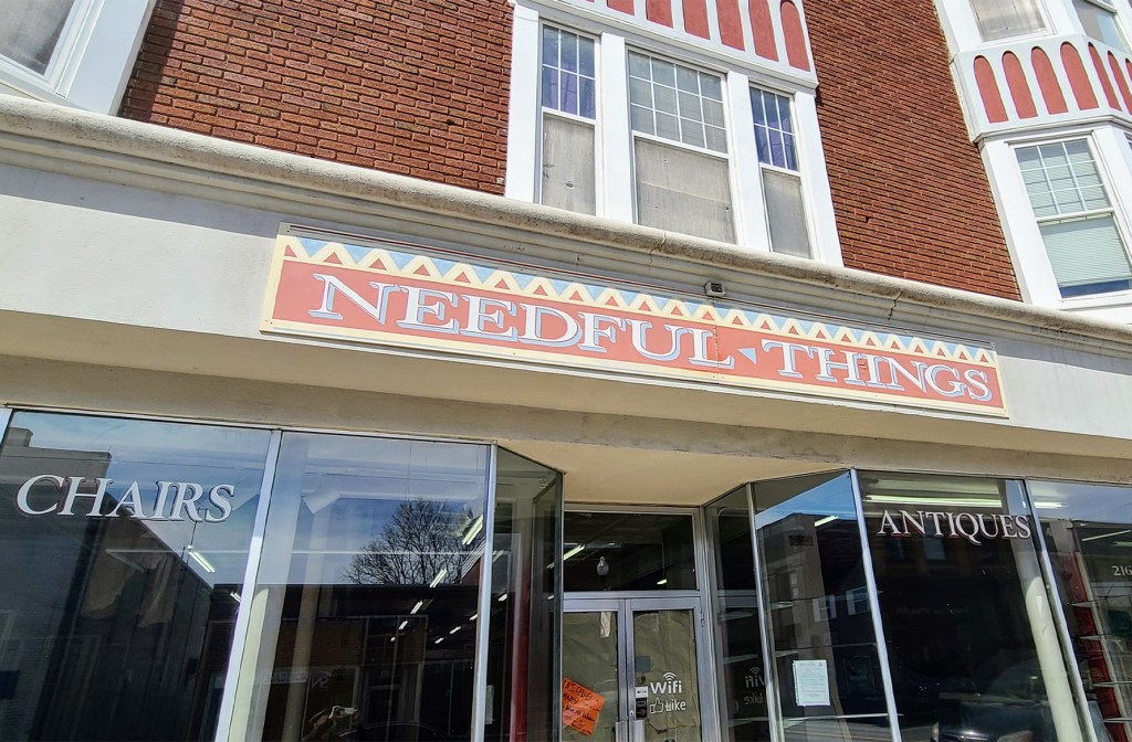 Storefront of the needful things shop.