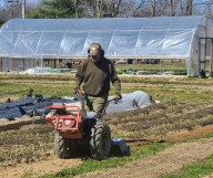 Michael Herbst uses the walk-behind tractor at the start of the season to break up the cover crop.