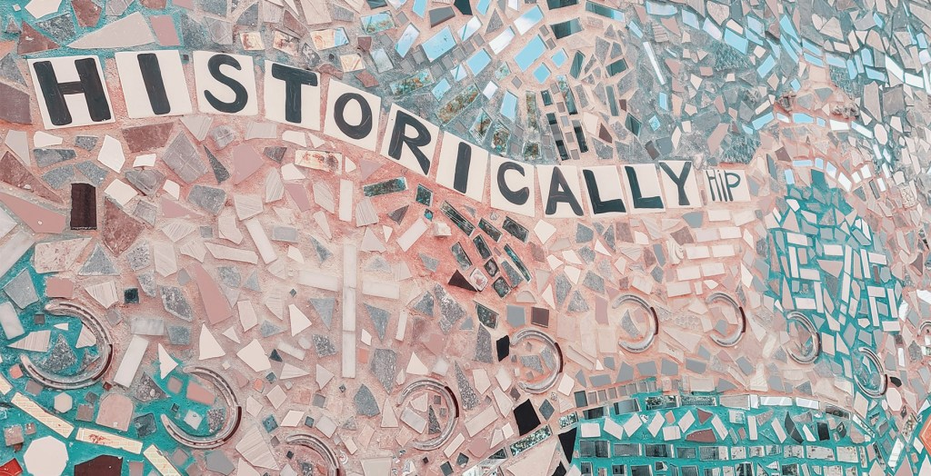 """A mural in Charles Town that incorporates the phrase """"historically hip."""""""