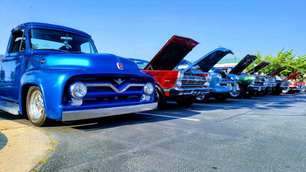 classic trucks lined up at the County Roads Cruise car show in Ranson.