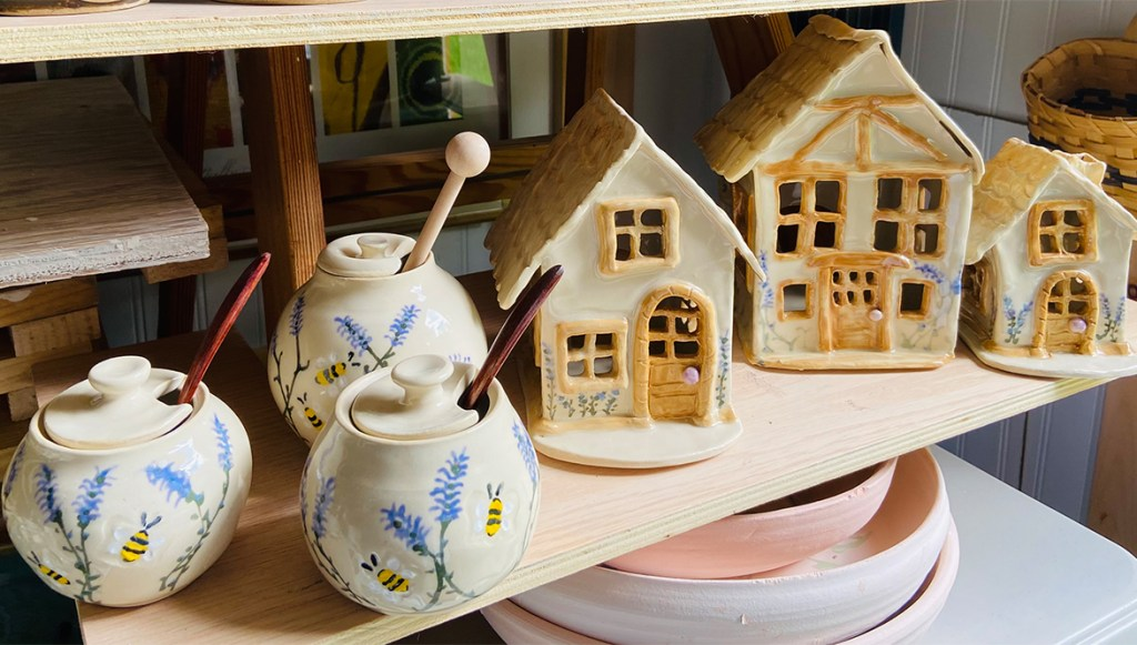 ceramic birdhouses and honey posts crated by LoCo Potters.