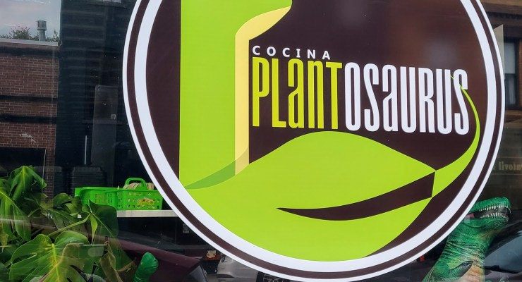 Window front of the new restaurant Cocina Plantosaurus in Charles Town.