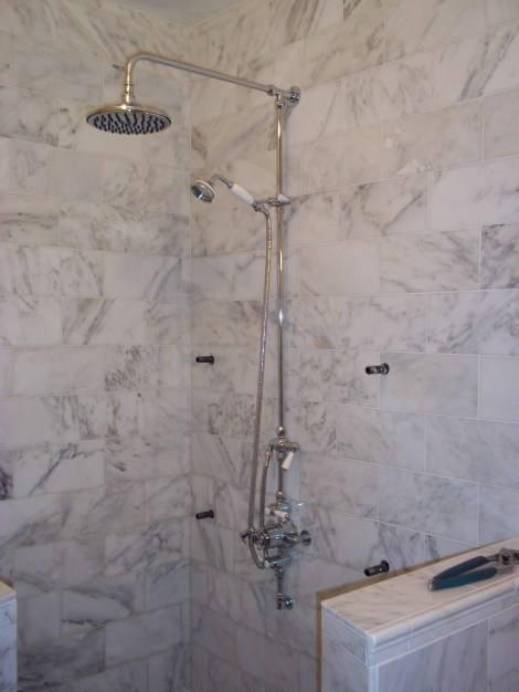 Exposed rain and wand shower fixtures