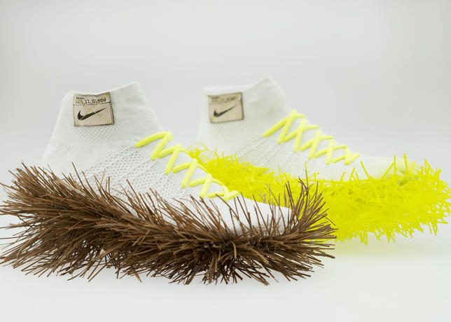 Taking inspiration from a directive delivered by Nike's very first employee, Jeff Johnson, this design attempts to recreate the soft, resilient underfoot sensation of running on pine needles, both natural and synthetic.