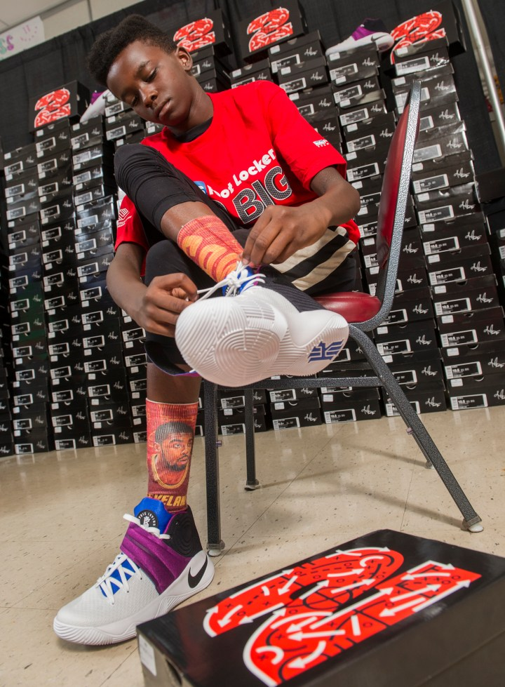 De'Lon Bush, 12, of Cleveland, tries on his Nike Kyrie II signature shoes, Saturday, July 9, 2016, in Independence, Ohio. Kids Foot Locker donated 190 pairs of sneakers to Boys & Girls Clubs of Cleveland, to match Cleveland Cavaliers star Kyrie Irving's 190 points scored during the NBA championship series.  (Phil Long/AP Images for Kids Foot Locker)