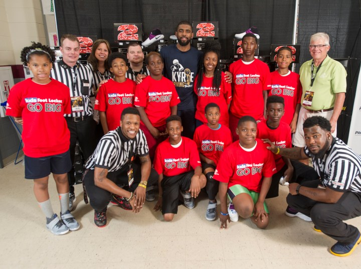Cleveland Cavaliers star Kyrie Irving, center, back row, poses with members of the Boys & Girls Clubs of Cleveland at his basketball camp Saturday, July 9, 2016, in Independence, Ohio. Kids Foot Locker donated 190 pairs of sneakers to BGCC, to match Irving's 190 points scored during the NBA championship series.  (Phil Long/AP Images for Kids Foot Locker)