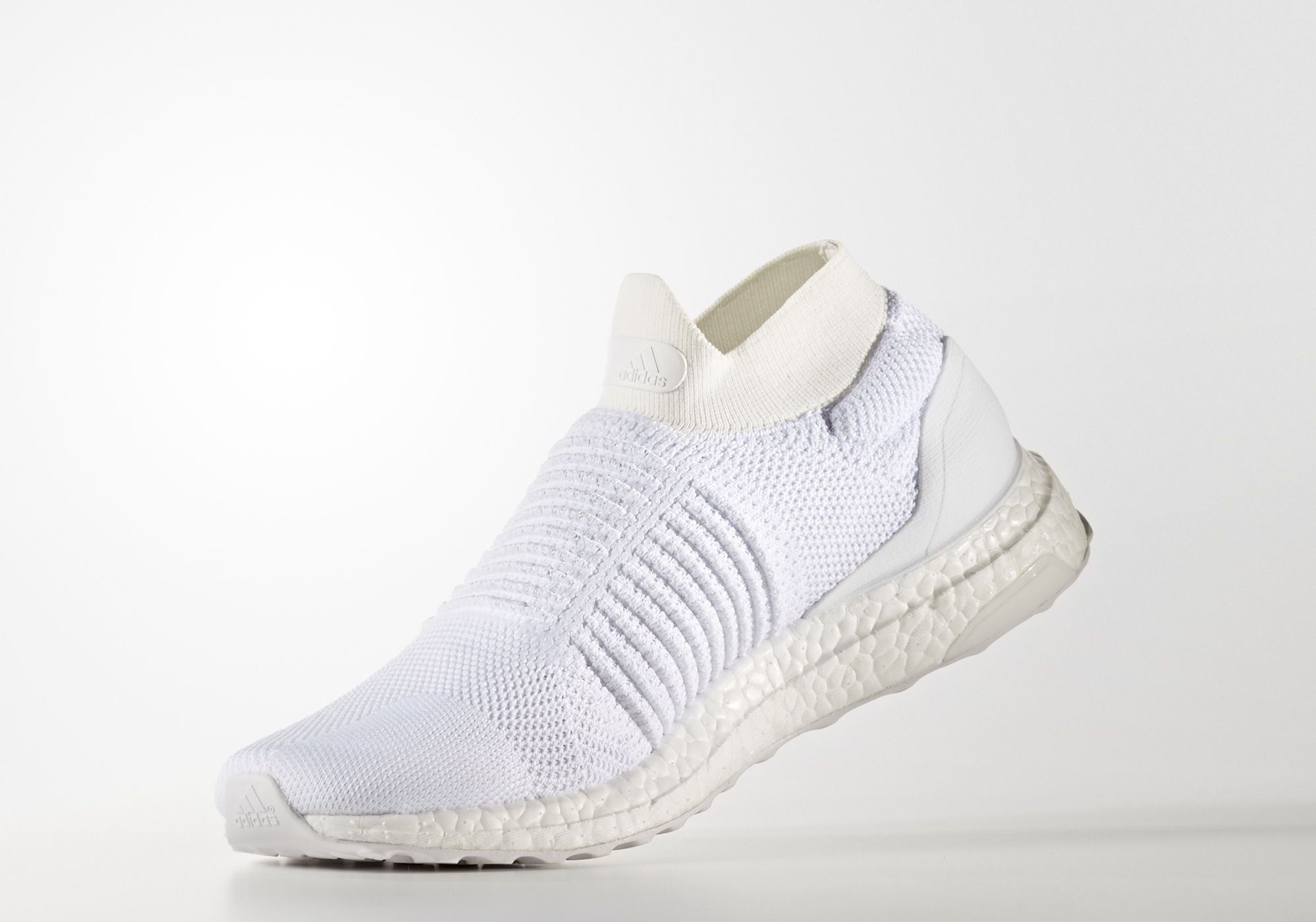 c369a21b5488f adidas Ultra Boost Laceless Mid Triple White Angle - WearTesters