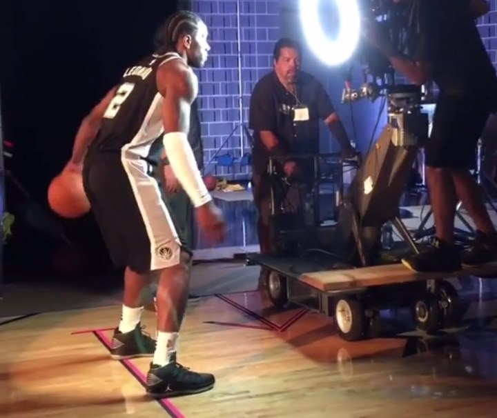 5263f464128b ... NBA Media Day. Kawhi Leonard in a black and grey Air Jordan 32 PE while  filming the Spurs opening video.