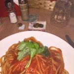 Spaghetti Bologna in a traditional restaurant in Toledo, street side