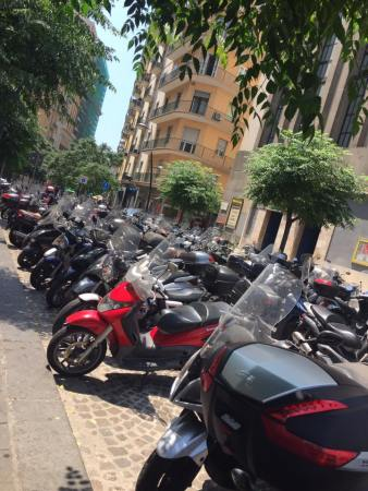 Loads of mopeds parked up on the streets of Napoli.