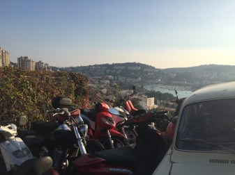 Mopeds with city backdrop