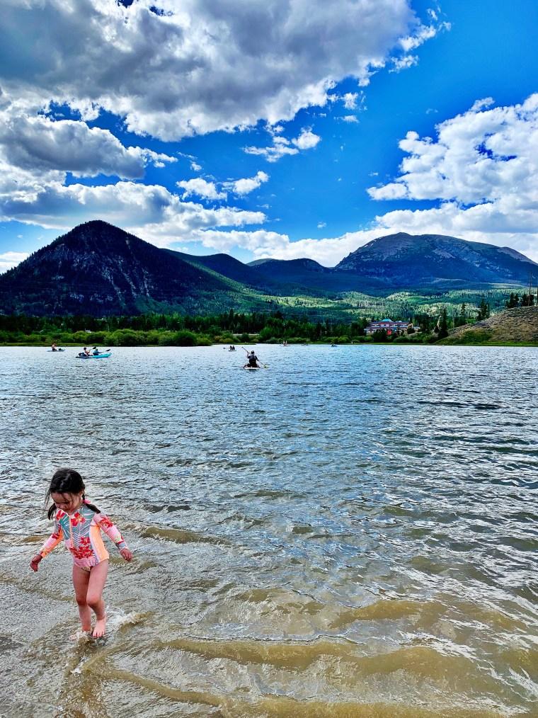 little girl playing in frisco bay marina, colorado