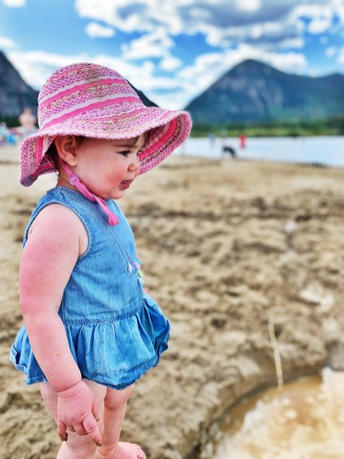 young girl staring at water in frisco bay marina, colorado