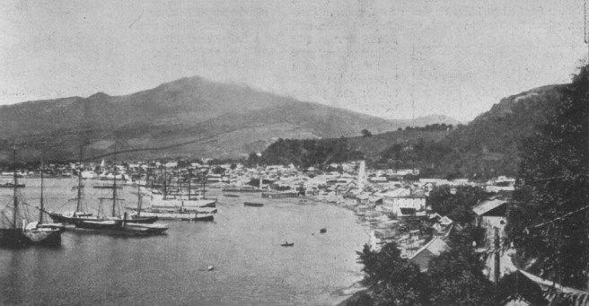 Saint Pierre in early 1902. Mt. Pelee is in the background.