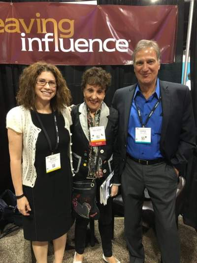 Bev Kaye and Chris Cappy grabbed a photo with Becky during their visit to the WI booth.
