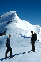 Grant Newton and a member of the Alpine club about to tackle<br /> the summit ridge of Mt Franklin