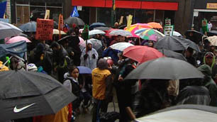 About 100 people gathered in wet weather to protest the Vancouver police crackdown.
