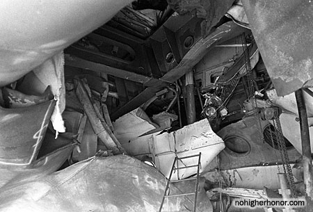 A view looking through the hole in the hull of the guided missile frigate USS SAMUEL B. ROBERTS (FFG-58), sustained when the ship struck a mine while on patrol in the Persian Gulf on April 14, 1988. Photo taken 3 May 1988. The ship was in dry dock undergoing temporary repairs.