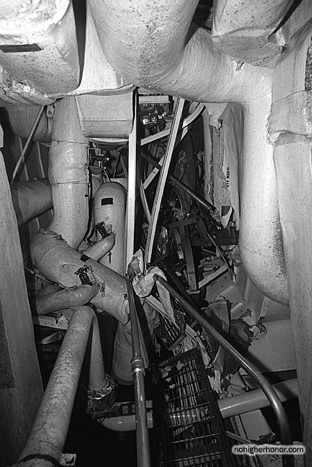 A view of an auxiliary machinery room on the guided missile frigate USS SAMUEL B. ROBERTS (FFG-58) damaged when the ship struck a mine while on patrol in the Persian Gulf on April 14, 1988. Photo taken 3 May 1988. The ship was in dry dock undergoing temporary repairs.