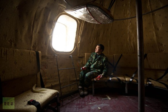 Farmer Liu Qiyuan sits inside one of seven survival pods that he has also dubbed ′Noah′s Arc′, in a yard at his home in the village of Qiantun, Hebei province, south of Beijing on December 11, 2012 (AFP Photo / Ed Jones)