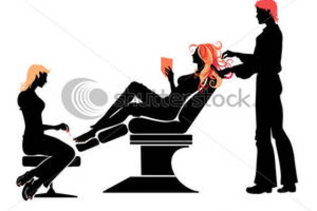 A busy hair salon, with many aestheticians working on clients' hair.
