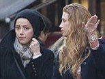 Low-key: Actress Amber Heard and model Marie de Villepin enjoy a Sunday stroll around the Saint Germain des Pres area of Paris