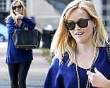 Reese Witherspoon is in a happy mood after lunch in Beverly Hills, looking great in a blue sweater with black tights, black boots and her black Valentino bag