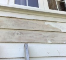 Scrape loose flaky paint off of exterior wood cladding ready for treatment.