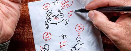 An image of a napkin showing a sketch of people sketching on napkins.