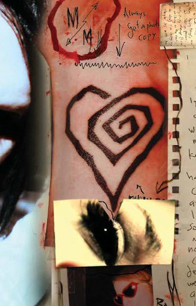 From the booklet for a Marilyn Manson album called Mad Love. Note that the hand and wrist are disembodied, with a line drawn between hand and wrist to indicate that these too will be cleaved apart. The heart is also piercing the picture of the eye below, out of which a triangle has been cut.