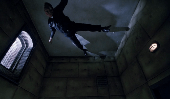 The priest hangs from the ceiling
