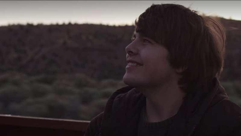 Jesse smiling in the back of a truck