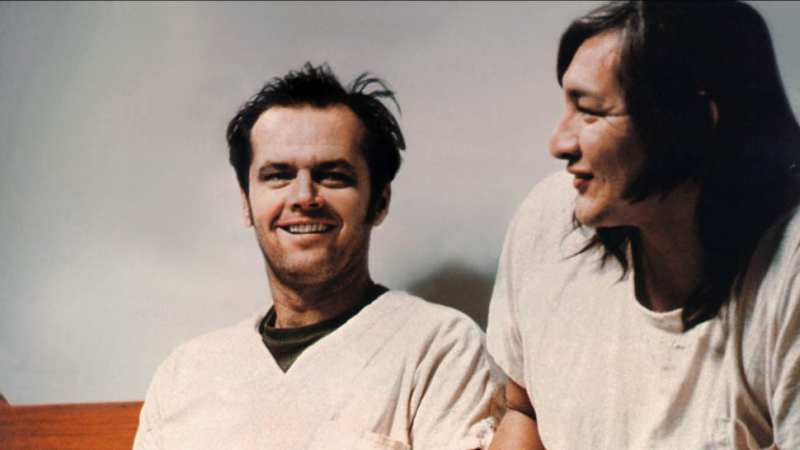 McMurphy and Chief laugh together